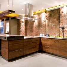 Mixing brick veneer with sleek contemporary textures in Toronto.