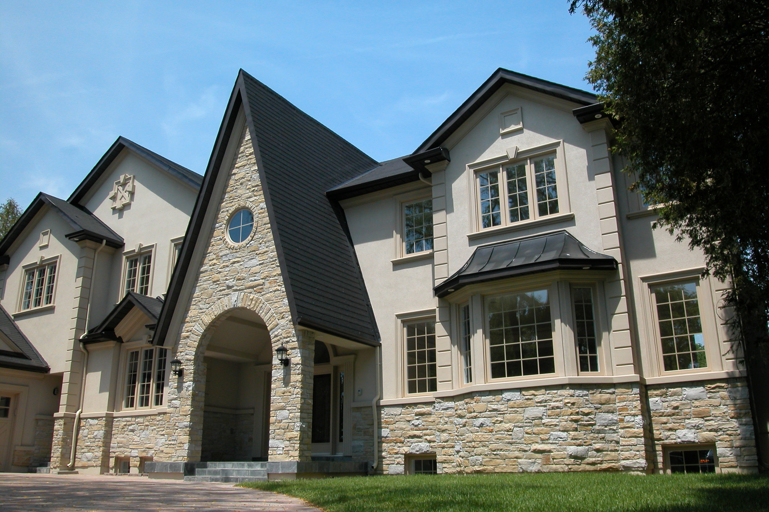 Perfect marriage of stone veneer and stucco finish for Exterior home accents